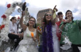 "(DENVER, CO., June 27, 2004) Parade goers atop a float called,"" My Big Fat Gay Wedding"" ..."