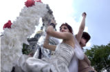 (DENVER, CO., June 27, 2004)  Ivana Repas, in wedding dress (left)  and Bryana Sylvester wave from...