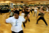"SPOTLIGHT Cenya Dickerson, center of Aurora, grooves to the hip-hop tunes during a ""Super..."
