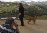 (Loveland Pass, Colo., July 12, 2004) Dan Hays takes a picture of his daughter, Liz Hays, 12, and...