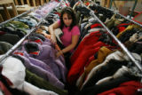 MJM300 Colorado Ski & Golf employee, Sharon Bustamante (cq) arranges winter jackets Monday as...