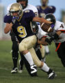 {3A} Division 3A Holy Family Tigers #9 Kevin Scherr make a 20 yard first down run in the first...