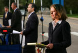 Leanne Gregg, of NBC News Channel, right, doees a live shot in a row of newscasters outside the...