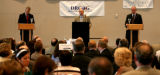 Rocky Mountain News business editor and moderator Rob Reuteman gives two debaters, Democratic...