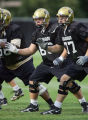 University of Colorado offensive linemen Brian Daniels (#66) and linemate Tyler Polumbus (#77)...