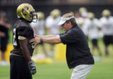 New University of Colorado head coach Dan Hawkins (right) works with tailback Cory Nabors (#32)...