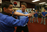 DLM01152  Leigh Ollerenshaw, 22, (right) tries to disarm  instructor Ranulfo Gonzales (left) as he...
