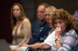 slug::.. Press Conference-5/6-3, -5.6.04- Silvey Acres Dr. resident Helen Beougher (right) listens...