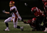 Northglenn wide reciever Sean Ortega, left, gets pulled on by his jersey as he slips past Fairview...