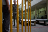 A Thai security guard walks through the courtyard of the detention center where John Mark Karr,...