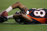 08/19/2006 Denver Broncos Rod Smith tries to stretch his reception into a touchdown, but couldn't...