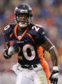 08/19/2006 Denver Broncos running back Mike Bell, #20, breaks away against the Tennessee Titans in...