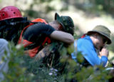 A Member of a group of marines searching the mountains in Eldorado Canyon State Park Sunday...
