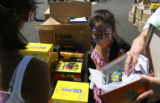Rosa Venegas, 8, of Aurora looks into a show box with brand-new shoes near the Lowery Town Center...