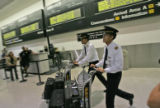 Poilots and of  Thai Airways International flight 794 leave the baggage claim area after touching...
