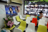 A woman sits in the waiting area at Pratunam Polyclinic in Bangkok on Monday, August 21, 2006. ...