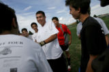 Miguel Rosales, 18, center, a senior goal keeper and captain for  the Smoky Hill Buffaloes keeps...