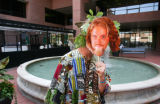 Denver Comedian Josh Blue puts a mask of his own face in front of his own before riding in the...