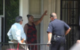 Denver Police interview a resident (unidentified) of a home where shots were fired at 3334 Jasmine...