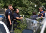 Denver Police investigate a scene where shots were fired at 3334 Jasmine Street Monday afternoon...