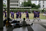 Thailand's Bangkok Christian College students gather in the courtyard for extra curricular...