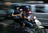 Students leave the Bangkok Christian College in Thailand at the end of their school day on...
