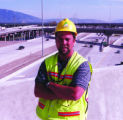 Doug Brannan,  construction chief of Salt Lake City's I-15 project, stands above a mild afternnon...
