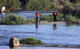 Dive teams search the South Platte River  north of W. Union Blvd. early Tuesday morning August...