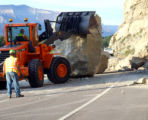 C-DOT workers try to move boulders that were part of the landslide that closed East bound  I-70 ...