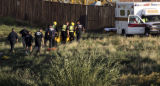 Dive teams pull a body out of the South Platte River  north of W. Union Blvd. early Tuesday...