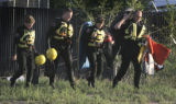 Dive team members leave the scene after pulling a body out of the South Platte River  north of W....