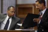L to R; Denver Police Crime Lab Detective Kevin Herbert (cq) and Prosecutor Tom Clinton in court...