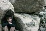 Jacob Ware(cq) of Chicago takes refuge beneath a rock near the peak of Mt. Evans Tuesday, Aug. 22,...