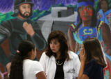 MJM624  Assistant principal, Elza Guajardo (cq), center, resolves a conflict between two students...