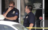 Aurora Police investigate a bank robbery at the Aurora Catholic Federal Credit Union on 2150 S....