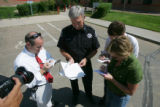 Commander Bruce Haas (cq), of the Boulder County Sheriff's Department talks with the media outside...