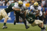 DLM01833   University of Colorado running back Hugh Charles rumbles through Colorado State...