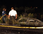 A DeBeque Colorado FireFighter attempts to Extinguish a pontiac on I-70 west of DeBeque at Mile...