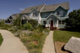 (Lafayette, Colo., July 8,  2004)    A row of houses at Nyland, a cohousing community in...