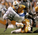 TNMH103 - Tennessee linebacker Marvin Mitchell (40) slams Air Force fullback Ryan Williams (21) to...