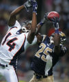 JPM1179 St. Louis Rams safety Corey Chavous, #25, intercepts a pass intended for Denver Broncos...
