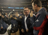 Denver Bronco's head coach Mike Shanahan, left, greets former offensive coordinator and current...