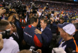 Denver Broncos' head coach Mike Shanahan shakes hands with Houston Texans' head coach Gary Kubiak...