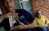 Gary Heit (cq), 49, left, holds a photo of his brother murdered brother Howard Chester Pilcher...