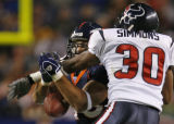 Houston Texans #30 Jason Simmons breaks up a first down pass to Denver Broncos #46 Chad Mustard in...