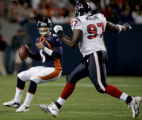 Denver Bronco's rookie quarterback Jay Cutler, left, gets pass rush by   Houston Texans defensive...