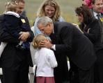 President George W. Bush kisses Makyla Blackford, grandaughter of United Flight 93 pilot Jason...