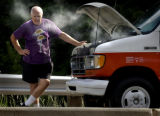 (MORRISON, Colo., July 14, 2004) John Clay from Leadville, Colorado stands next to a rented truck...