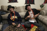 left, Tenzen Desel and right, Tenzin Loden, together share a laugh having put on their traditional...