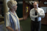 (SHERIDAN, Colo., JUNE 30, 2004)  Sheridan Schools Superintendent Mike Poore speaks with Kathleen...